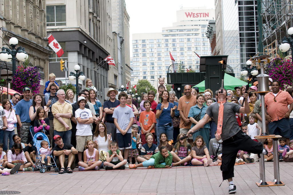 A busker performs in front of a captive audience.